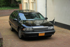 Black hearse. Parked outside a funeral home Royalty Free Stock Image