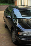 Black hearse. Parked outside a funeral home Stock Images