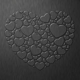 Black heart on metal sheet Stock Photography
