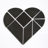 Black heart puzzle Stock Photos