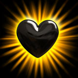 Black heart in the rays of light Royalty Free Stock Photography