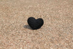 Black heart on the rocks and shadows Royalty Free Stock Images