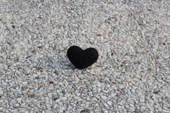 Black heart on stone Royalty Free Stock Photo