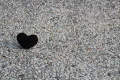 Black heart on stone Stock Photography