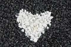Black and heart white stones texture Stock Photo