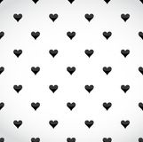 Black hearts patter over a white background Stock Image