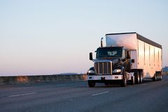 Black heavy class big rig semi truck with day cab for local deli Royalty Free Stock Image