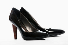 Black heels. A picture of a pair of black heels over white background Stock Photos