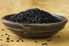 Black Heirloom Forbidden Rice. In a pottery bowl stock photos