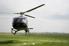 Black Helicopter. A flying helicopter, getting started Stock Photos
