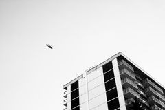 Black Helicopter Flying Above the Building Royalty Free Stock Image