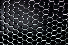 Black hexagonal mesh honeycomb grid background Royalty Free Stock Photo