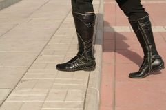 Black high boots. Black; high; boots; woman; step; leather; calf Royalty Free Stock Images