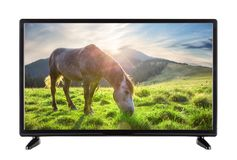 Black High Definition TV with picture of horse. On the grass of the mountains Stock Image