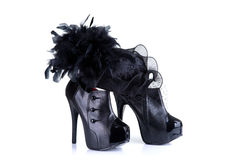 Black high heel female shoes and elegant feather hat Royalty Free Stock Image