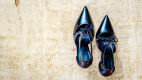 Black high heel shoes on grungy wood Stock Image
