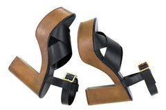 Black high-heel shoes with open toe cross strap platform sandals. Side view of Black high-heel shoes with open toe cross strap platform sandals with brown chunky Royalty Free Stock Photo