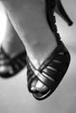 Black High Heels. A close up of a woman wearing high heels Royalty Free Stock Photography