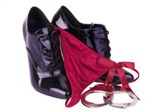 Black high heels, handcuffs and g-string Royalty Free Stock Image
