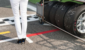 Black high heels and racing tire Stock Photos