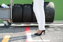Black high heels and racing tire Royalty Free Stock Images