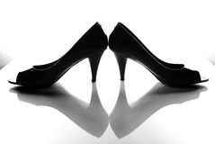 Black High Heels Reflected. An image of black leather high heels and a reflection Royalty Free Stock Images