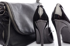 Black high heels shoes with a black handbag Stock Images