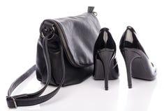 Black high heels shoes with a black handbag Royalty Free Stock Image