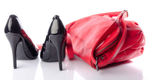 Black high heels shoes with a red handbag Royalty Free Stock Image