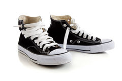 Black high top sneakers on white. Black canvas high top sneakers or tennis shoes on a white background Stock Photos