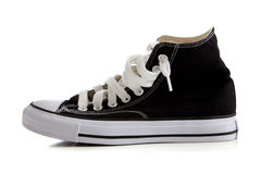 Black high top sneakers on white. Black canvas high top sneakers or tennis shoes on a white background Stock Photo