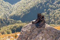 Black hiking boots on the rock. Black hiking jungle boots on the rock Stock Photo