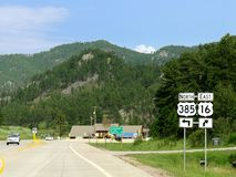 Black Hills, South Dakota photos. Black Hills, South Dakota--July 2018: Directional signs on the road with directions to the north and east to Deadwood and Rapid stock image