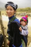 Black Hmong woman and baby. The Hmong live in small community of some houses. Hmong women have the best clothes of all minorities in Vietnam in general. Their Stock Image