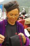 Black Hmong woman embroidering his turban royalty free stock photos