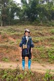 Black Hmong woman in Sapa. Sapa, Vietnam-December 13, 2013. Black Hmong woman on the way to Muong Hoa Valley, there are mainly five ethnic groups, on December 13 Stock Photo