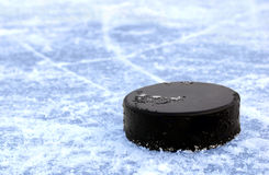 Black hockey. Puck on ice rink Royalty Free Stock Image