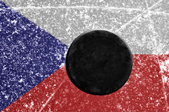 Black hockey puck on ice rink Royalty Free Stock Photos
