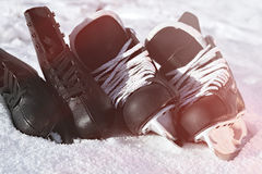 Black hockey skates and for figure skating. snow, bright sun stock photos