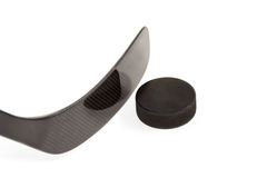Black hockey stick with washer Stock Images
