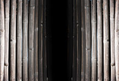 Black hold between old bamboo pannel Royalty Free Stock Photography