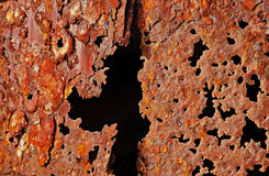 Black Hole in the Old Rust. Black hole in the rusty texture Royalty Free Stock Photography