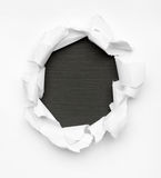 Black hole in white paper Royalty Free Stock Images