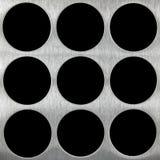 Black holes on aluminum surface Stock Photos