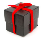 A black holiday box. A holiday box decor on holiday background Royalty Free Stock Images