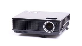 Black home cinema projector, isolated on white. Background royalty free stock photos