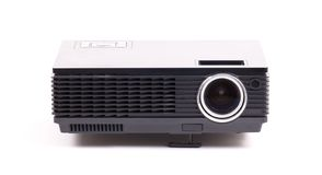 Black home cinema projector, isolated on white. Background stock photography