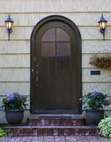Black home door Stock Images