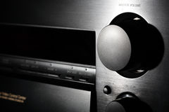 Black home theater amplifier with volume knob clos Royalty Free Stock Image