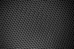Black honeycomb background Stock Photos